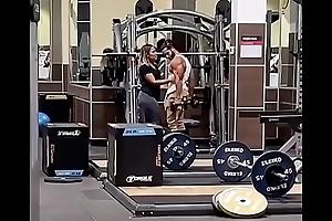 Couple Giving a kiss regarding Gym