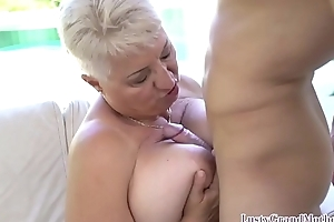 Busty gilf seduces young guy into offbeat carnal knowledge