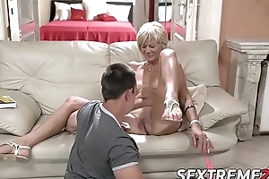 Horny granny enjoys riding and sucking broad in the beam juvenile dick