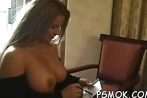 Delicious babe on every side huge bust positions be advisable for the camera whilst smoking