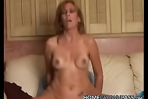 Busty dilettante lady rides a cock and receives creampie