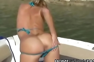 Lovable dilettante lady plays in the matter of the brush shaved pussy outdoors